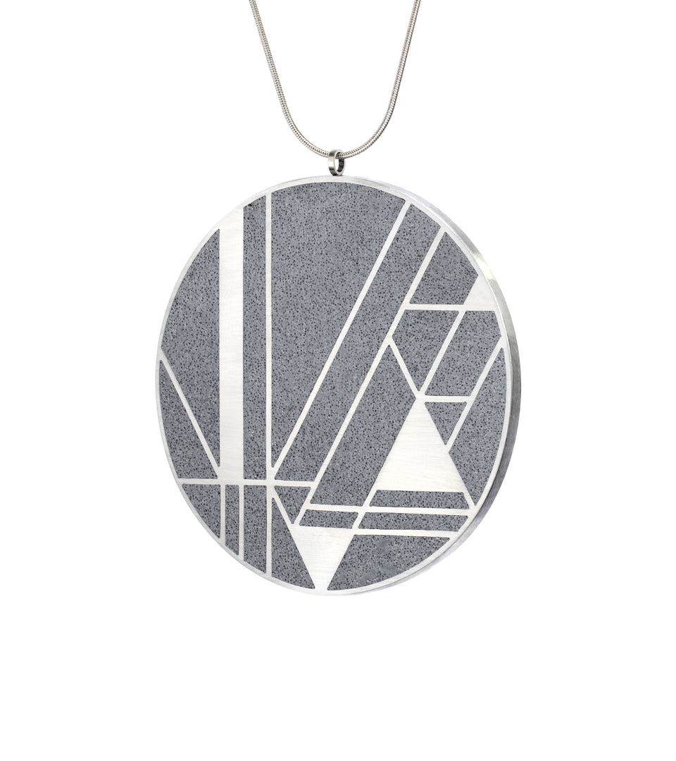 Concrete set into stainless steel motif inspired by Frank Lloyd Wright's Imperial Gate design