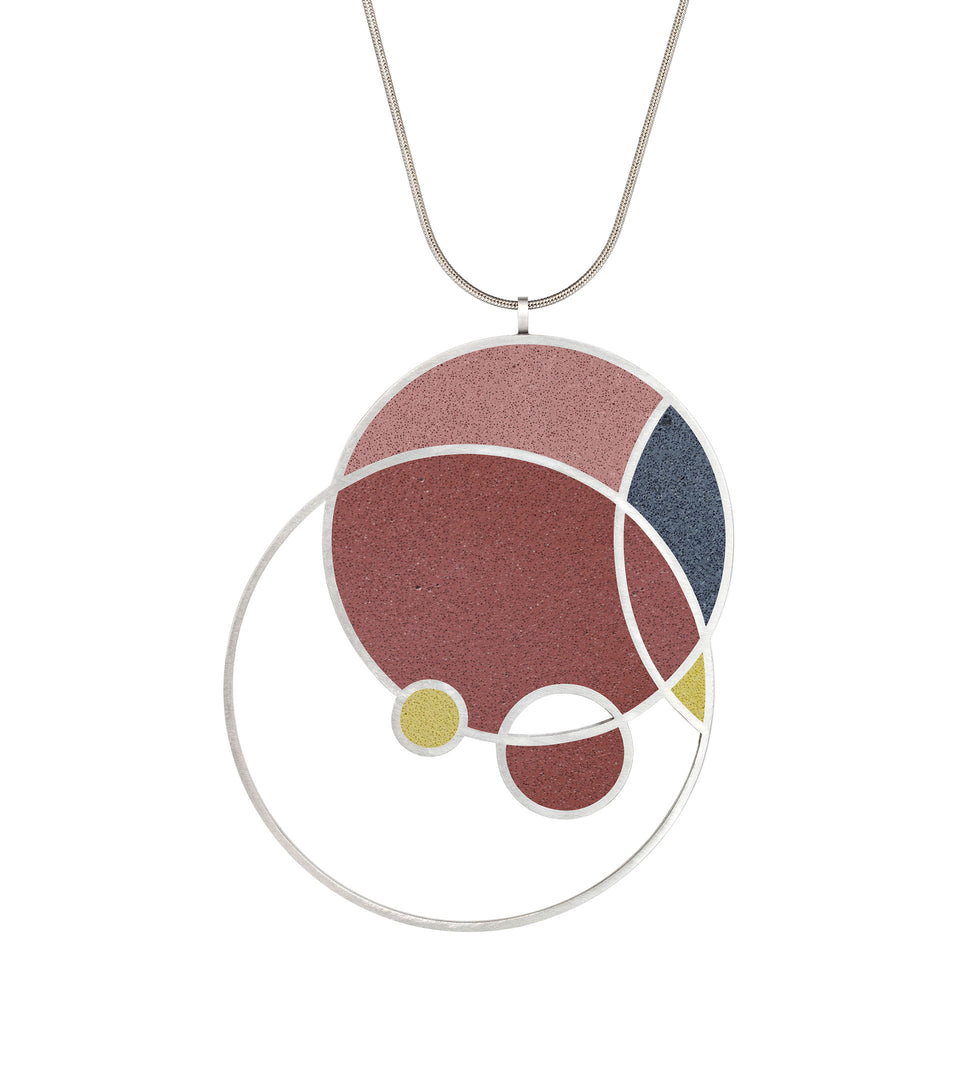 Frank Lloyd Wright concrete necklace in Taliesin Red, Indigo Blue and Flax Yellow colorway.