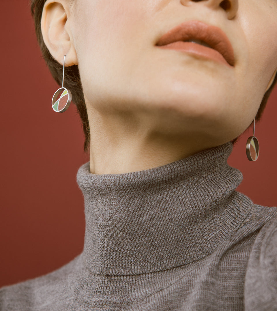 Frank Lloyd Wright inspired concrete and stainless steel earrings.