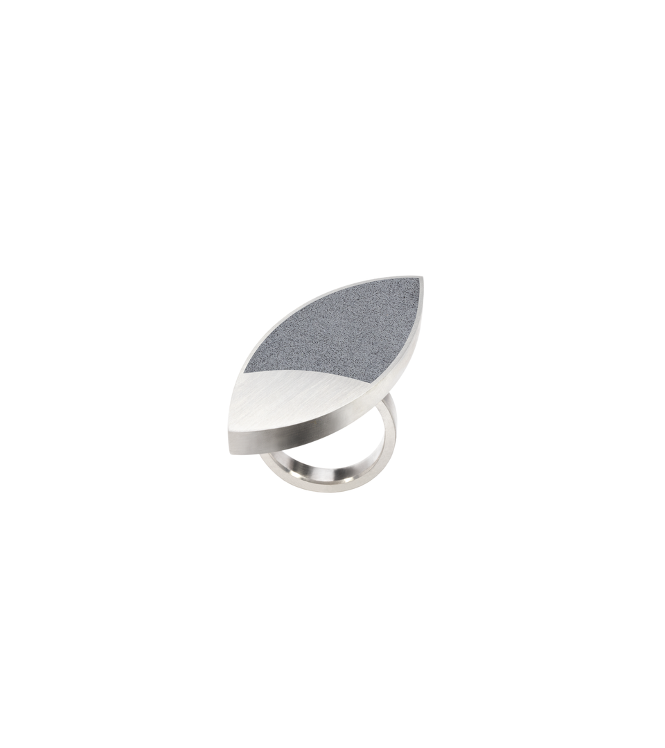 Concrete set into leaf-shaped stainless steel ring inspired by Frank Lloyd Wright's March Balloons artwork.