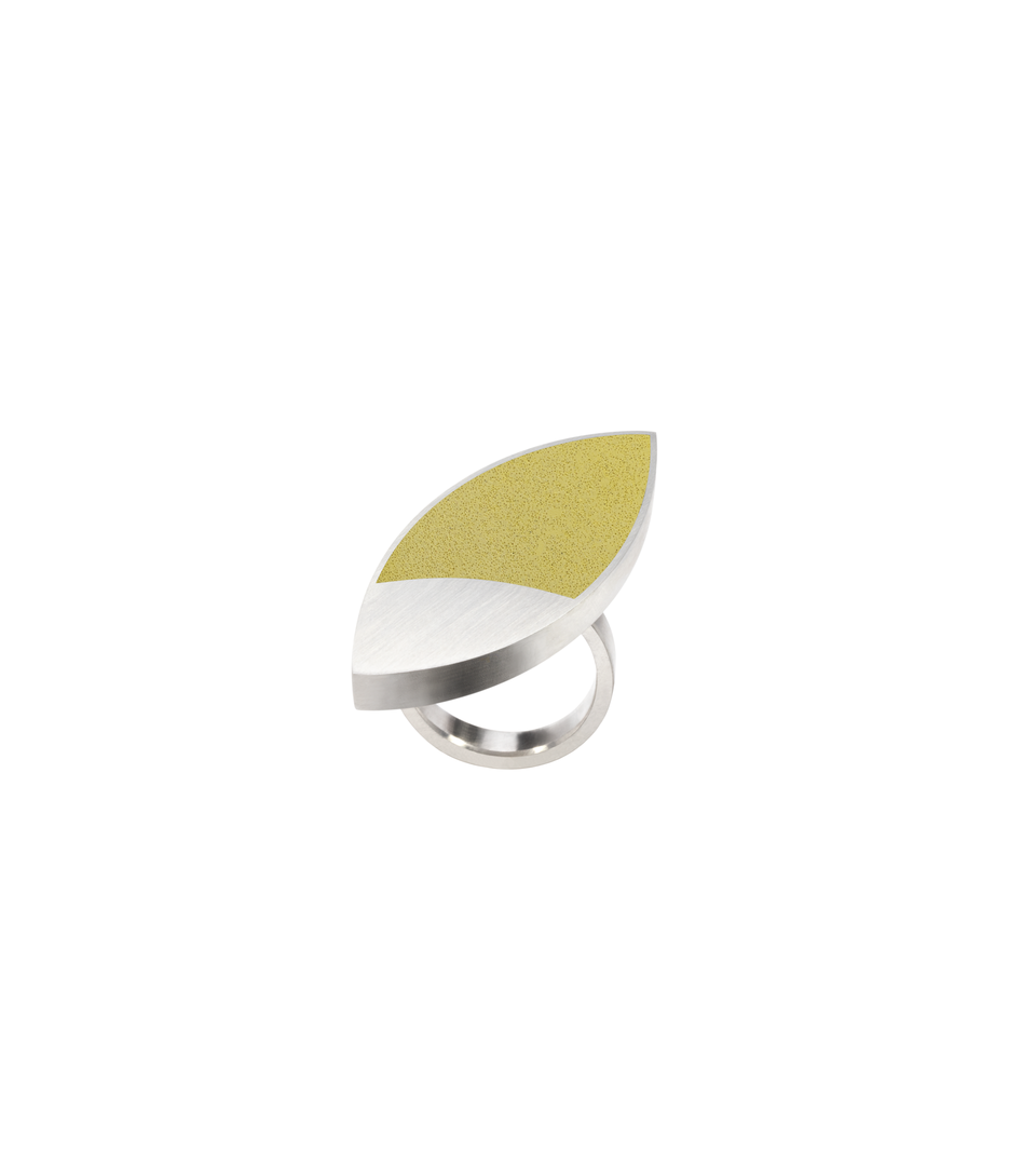Flax Yellow concrete ring set into leaf-shaped stainless steel ring inspired by Frank Lloyd Wright's March Balloons artwork.