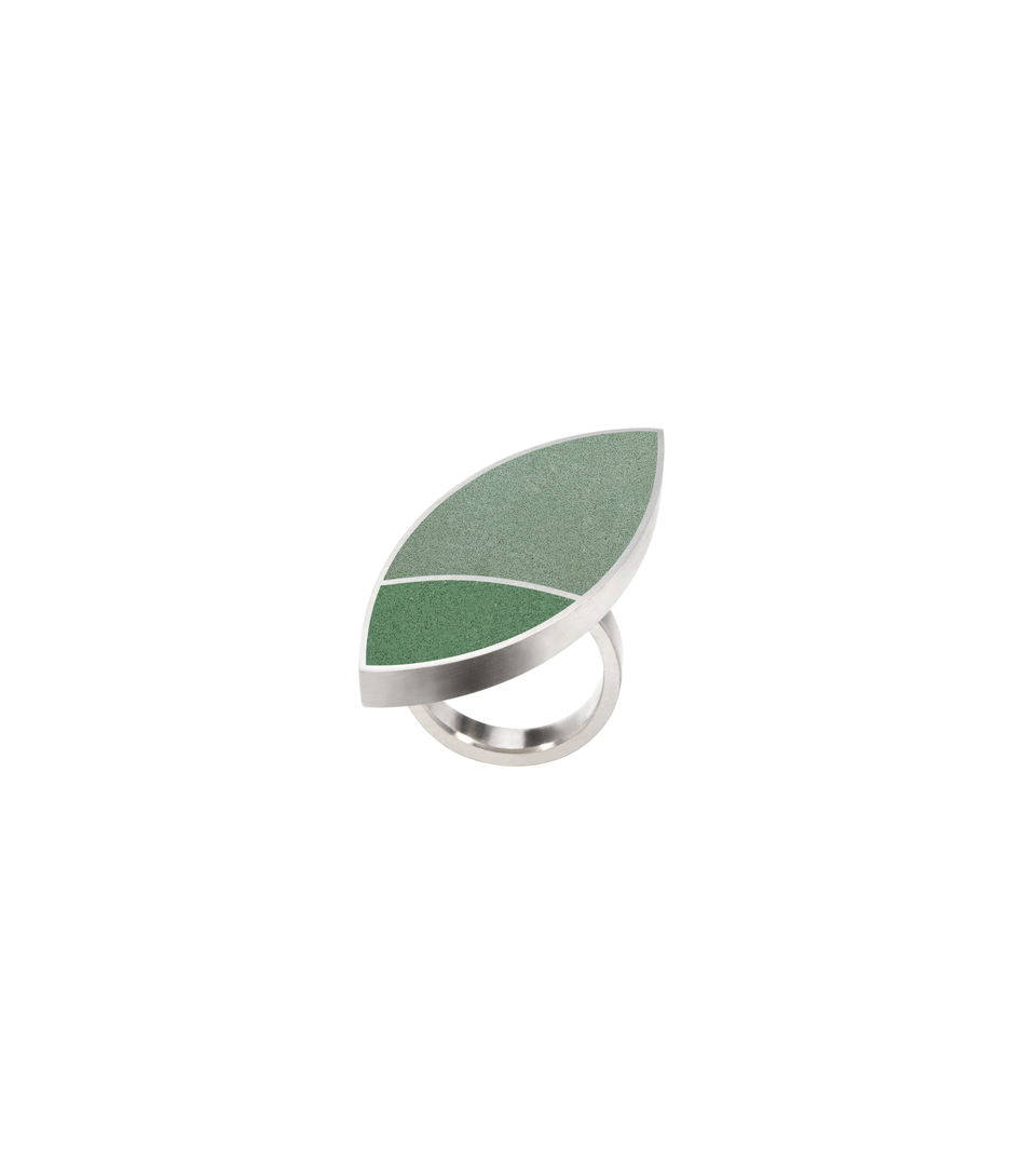 Concrete set into leaf-shaped stainless steel ring inspired by Frank Lloyd Wright's March Balloons.