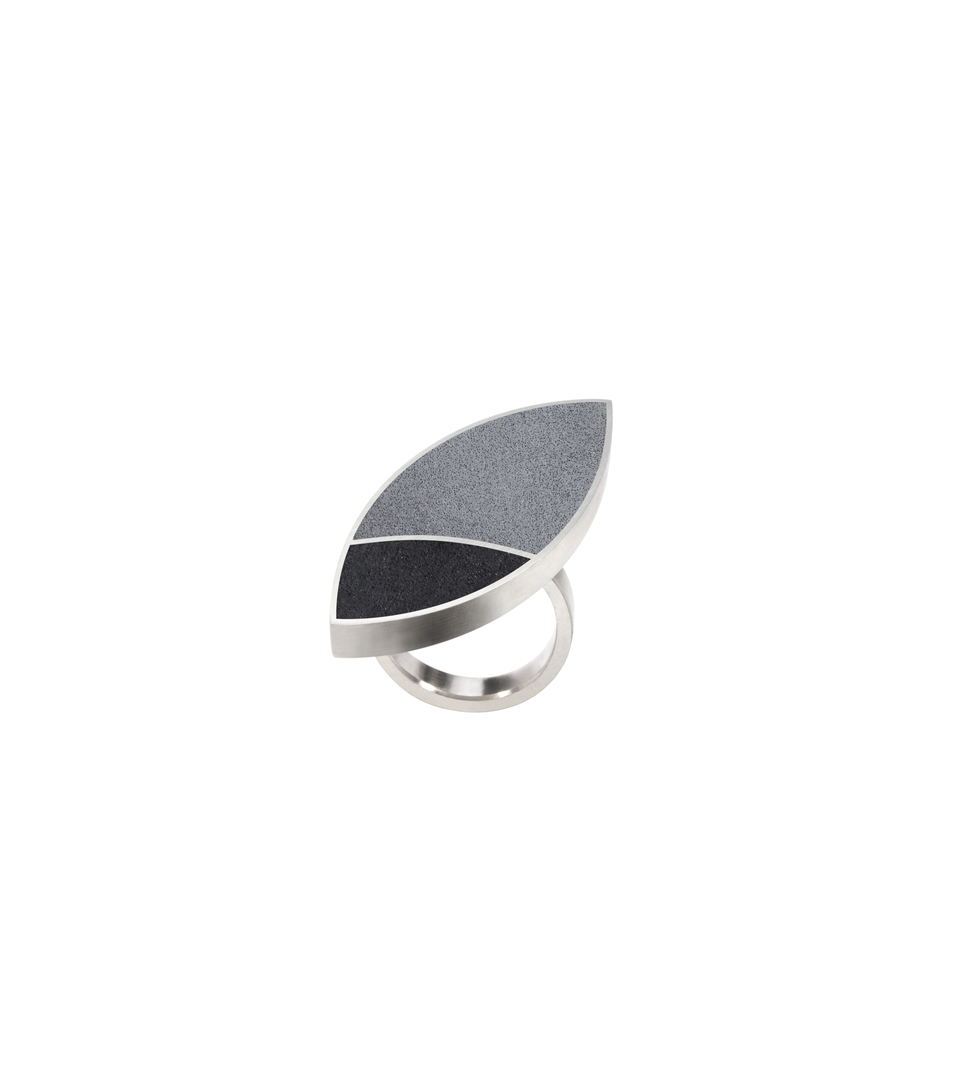 Concrete set into Frank Lloyd Wright inspired leaf-shaped stainless steel ring.