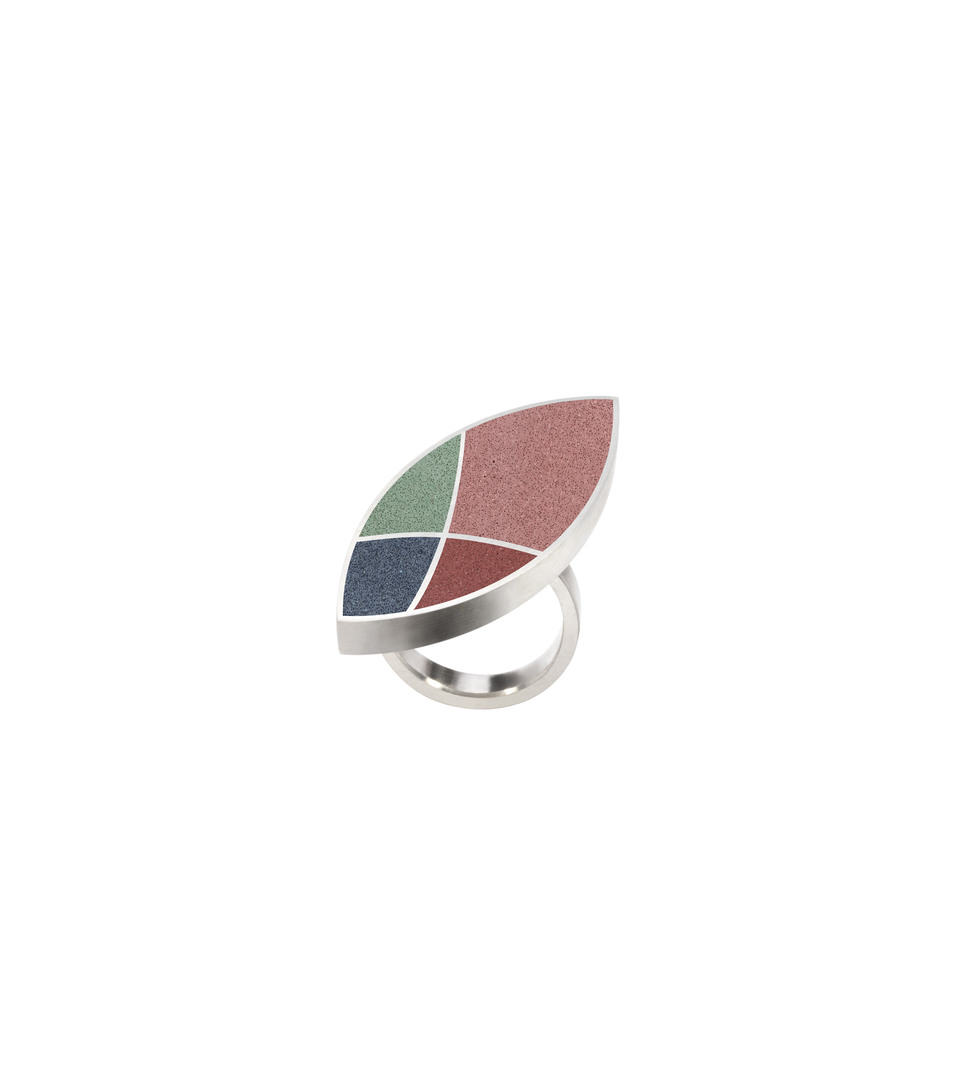 Concrete set into leaf-shaped stainless steel ring inspired by Frank Lloyd Wright's March Balloons motif.