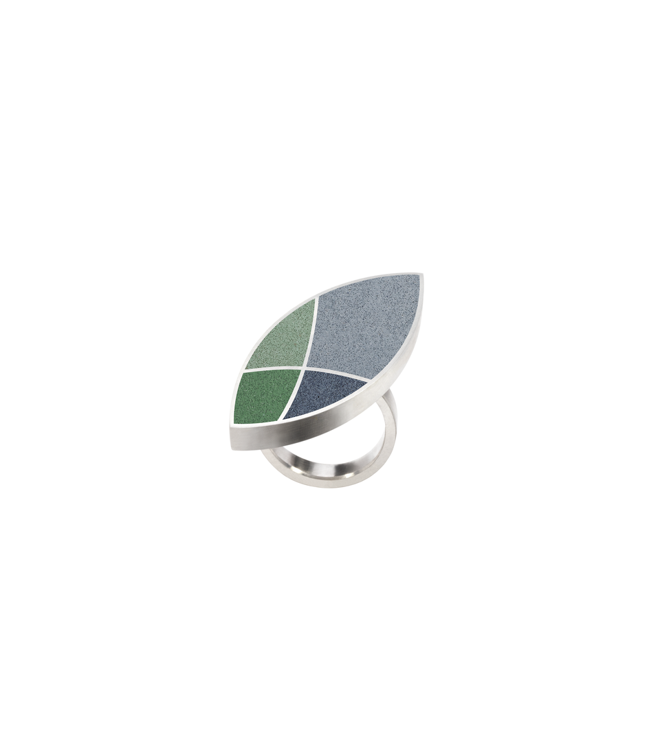 Concrete tinted in custom colors. Set into leaf-shaped stainless steel ring with motif inspired by resulting shapes from overlapping circles in Frank Lloyd Wright's March Balloons.