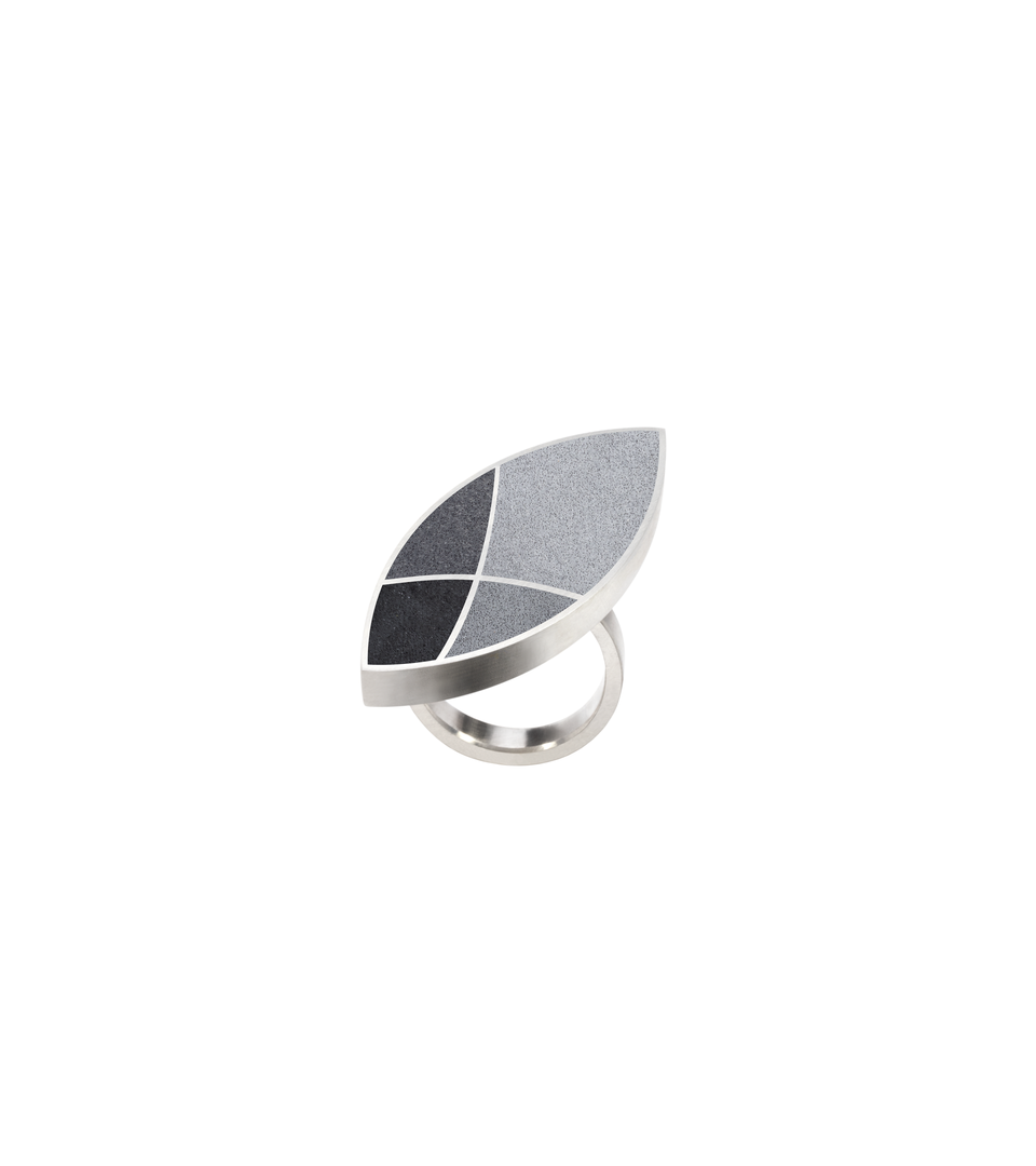 Concrete set into stainless steel leaf-shaped ring with motif inspired by resulting shapes from overlapping circles in Frank Lloyd Wright's March Balloons.