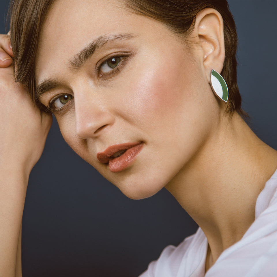 Concrete set into leaf-shaped stainless steel earring studs inspired by Frank Lloyd Wright's Saguaro Form and Cactus Flowers.