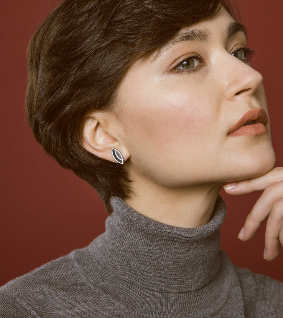 Concrete leaf-shaped earrings design influenced by the work of architect Frank Lloyd Wright.