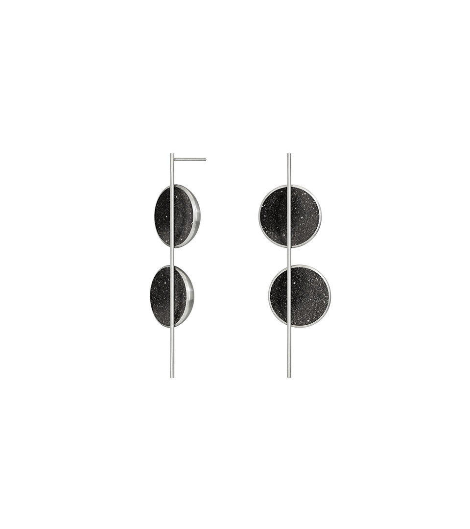 The Arago earrings sparkle with diamond dust infused black concrete set into two asymmetrically placed stainless steel dome connected behind a vertical steel post.