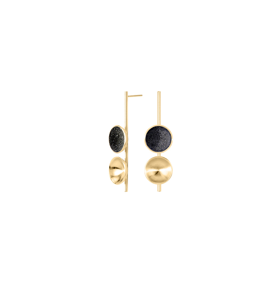 Freya Minor earrings feature the modern design of two double solid 14 karat gold domes, one lined with diamond dust infused black concrete both architecturally supported an elegant hanging 14k gold post.