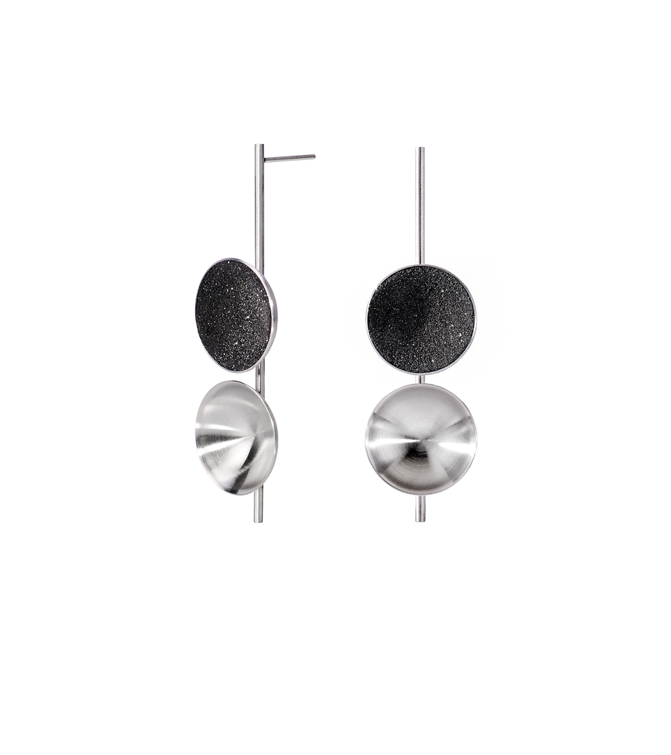 Freya are modern earrings featuring two double stainless steel domes, one lined with diamond dust infused black concrete both architecturally supported an elegant hanging steel post.