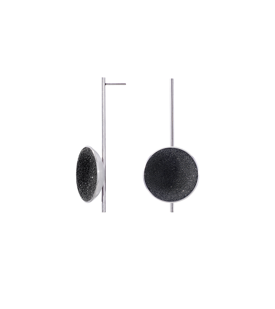 Bauhaus inspired Inspira Major earrings sparkle with diamond dust and black concrete set into a medium sized stainless steel dome architecturally suspended on top of a minimalist steel post.