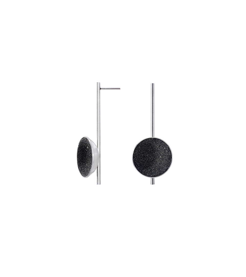 Inspira earrings feature authentic diamond dust embedded into a concrete lined stainless steel dome architecturally positioned onto a suspended minimalist steel post.