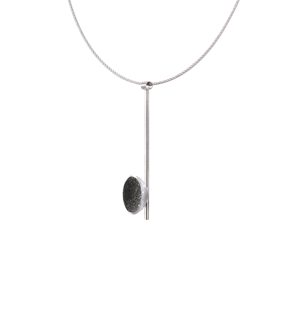 Side view of the Inspira Minor necklace featuring authentic diamond dust embedded into a concrete lined stainless steel dome architecturally positioned onto a suspended minimalist steel post.