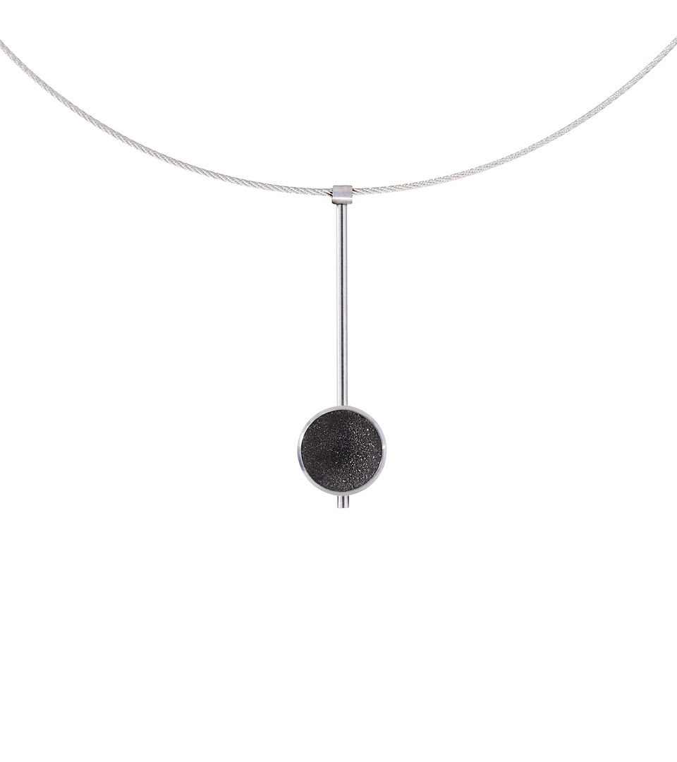 The Inspira Minor necklace feature authentic diamond dust embedded into a concrete lined stainless steel dome architecturally positioned onto a suspended minimalist steel post.