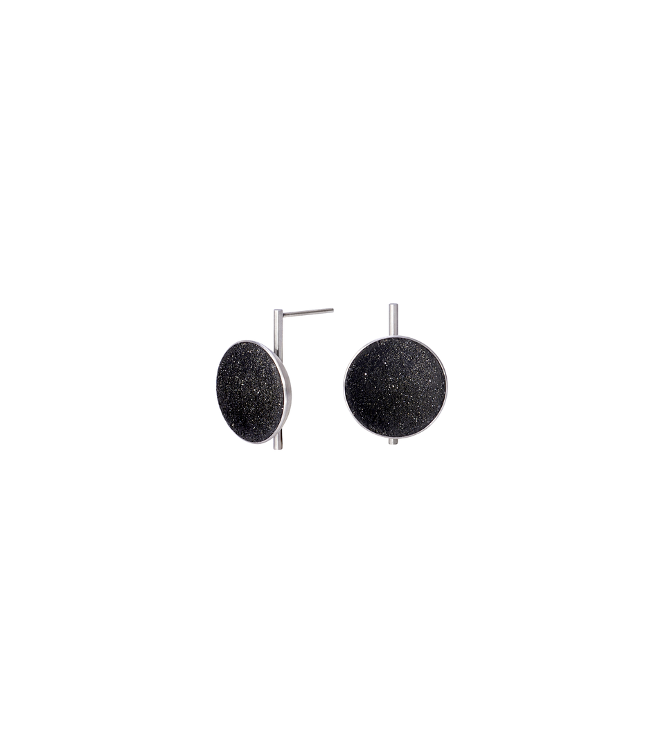 Juno earrings feature authentic diamond dust embedded into a concrete lined stainless steel dome architecturally positioned onto a minimalist steel post.