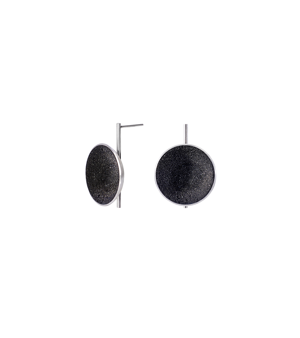 Juno Major earrings feature genuine diamond dust infused into concrete lined stainless steel domes perched onto a vertical steel post.