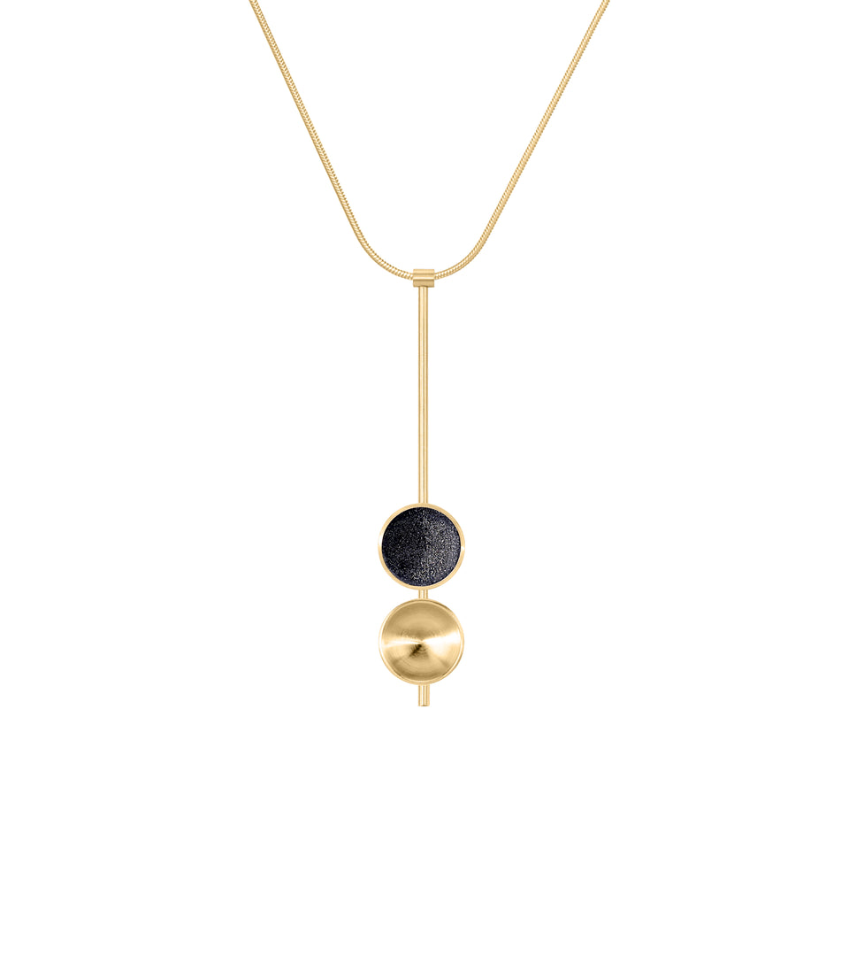 The Freya Minor modern necklace features two double solid 14 karat gold domes, one lined with diamond dust infused black concrete both architecturally supported an elegant hanging 14k gold post.
