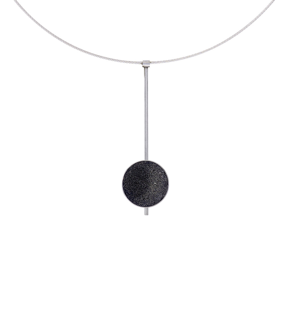 The Inspira necklace feature authentic diamond dust embedded into a concrete lined stainless steel dome architecturally positioned onto a suspended minimalist steel post.