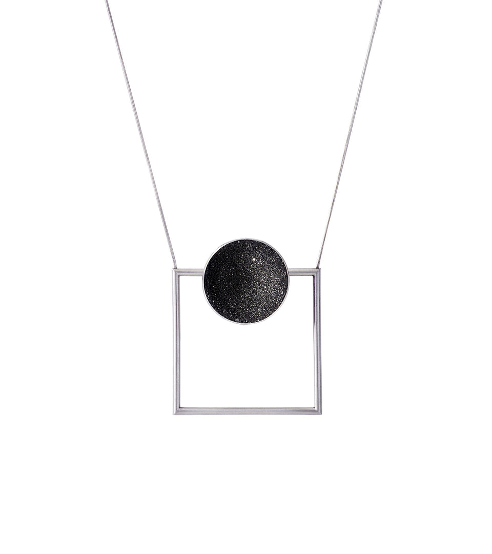 Contemporary necklace combines the geometry of a smaller stainless steel dome lined with the sparkle of diamond dust encrusted concrete suspended onto a minimalist steel square frame.