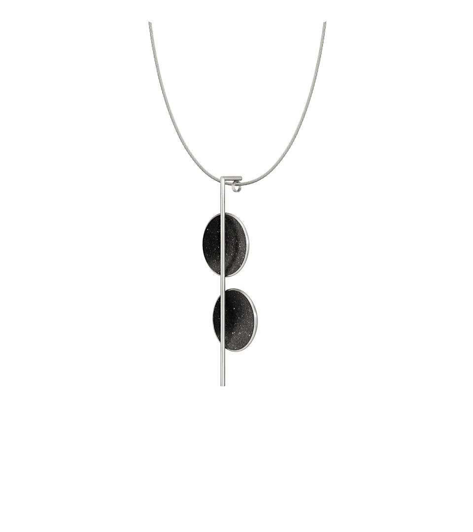 Bauhaus design inspired jewelry featuring black concrete and the sparkle of diamond dust set into two stainless steel domes suspended from a small steel post and necklace cable.