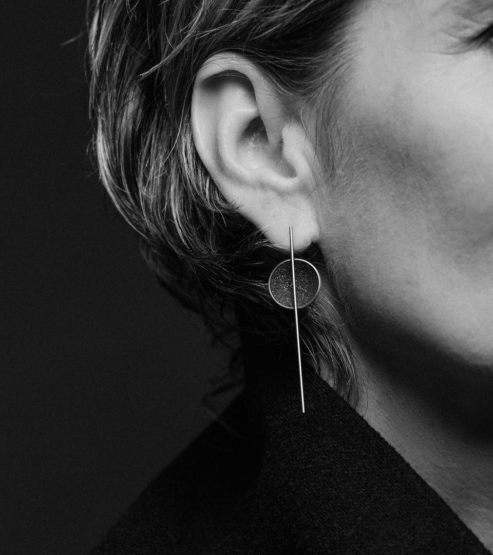 Infini earrings are designed with Diamond dust infused concrete lined stainless steel dome intersected by the bauhaus like detail of a minimalist steel post.