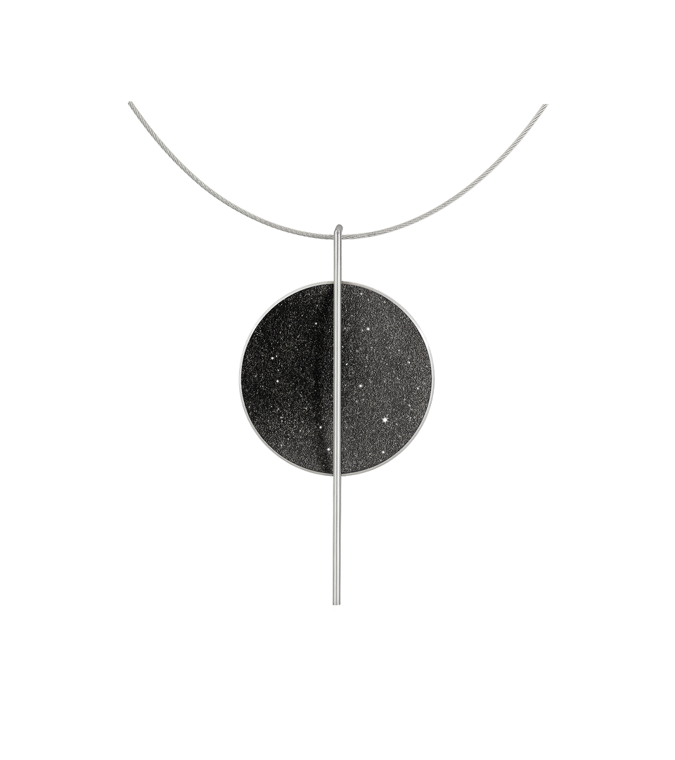 The bauhaus inspired Linnea Major necklace sparkles with diamond dust and black concrete set into a stainless steel dome suspended onto an intersecting steel post.