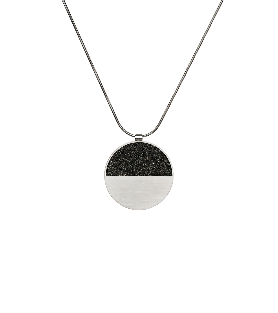 Mira concrete and diamond dust necklace achieves minimalist beauty with modernist jewelry design that echoes architectural principles of balance, rhythm and harmony.
