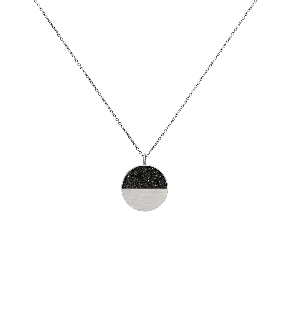 Mira minor concrete and diamond dust necklace achieves minimalist beauty with modernist jewelry design that echoes architectural principles of balance, rhythm and harmony.