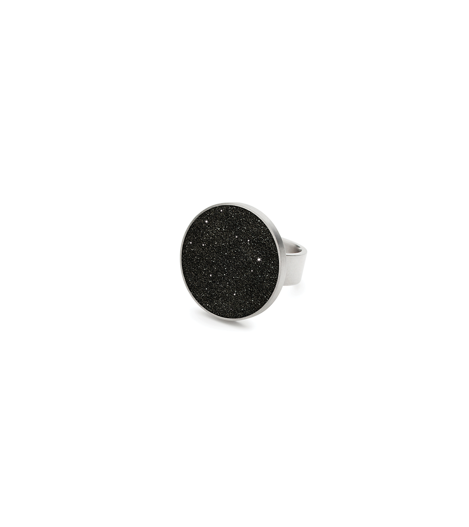 The Antares stainless steel ring set with diamond dust infused black concrete.