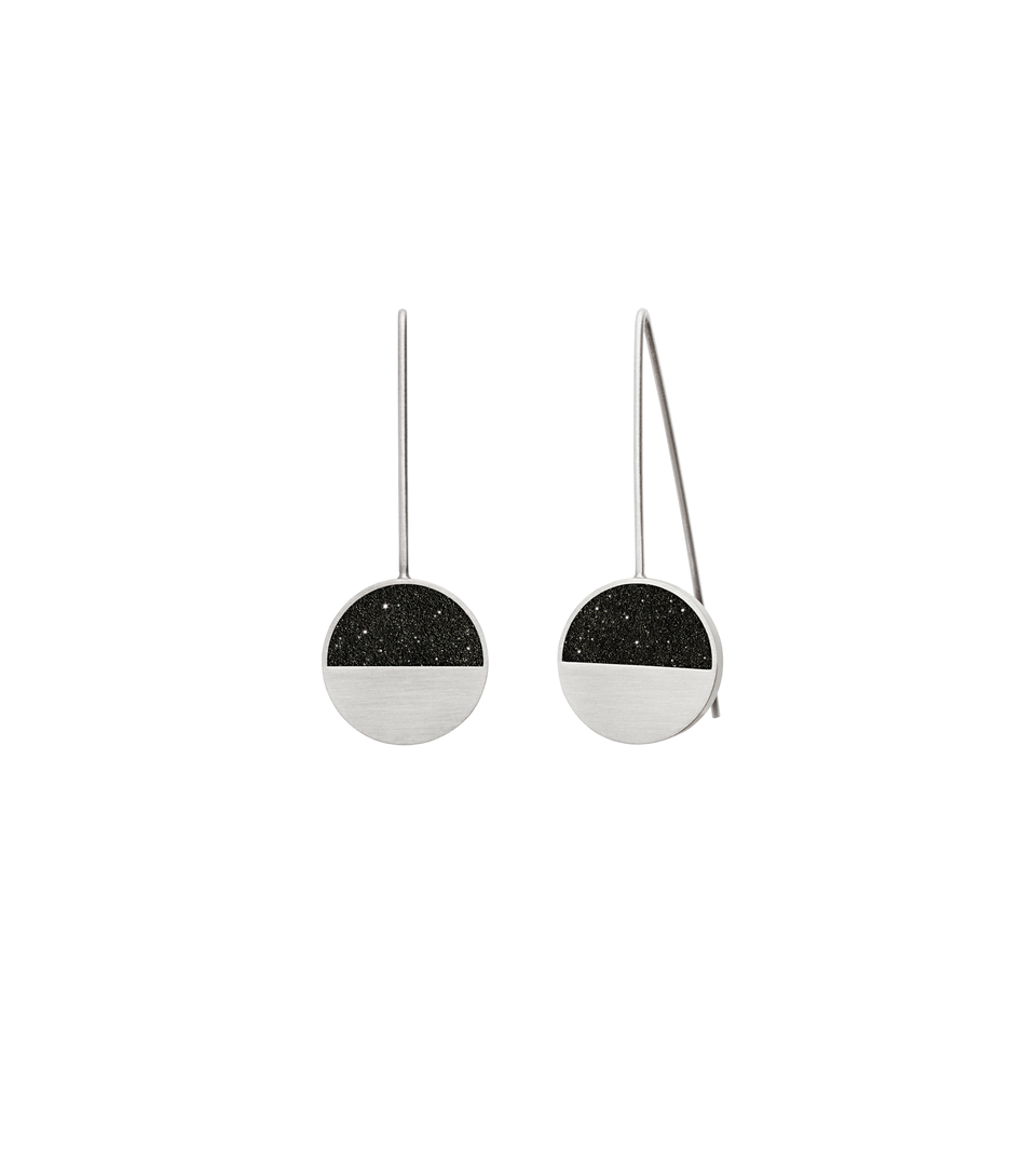 Capella Minor diamond dust infused concrete earrings balance within stainless steel geometric forms.