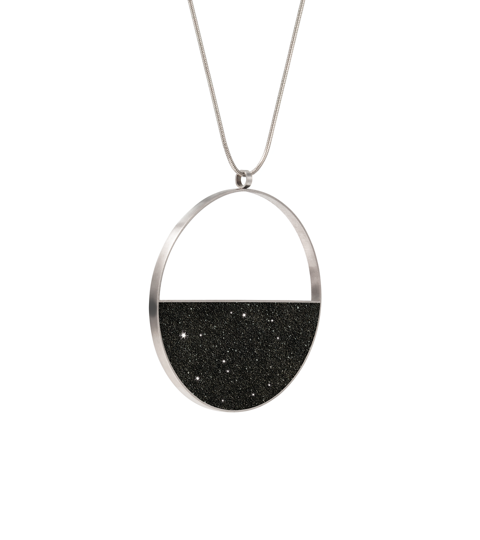 Carina Nebula concrete and diamond dust necklace achieves minimalist beauty with modernist jewelry design that echoes architectural principles of balance, rhythm and harmony.