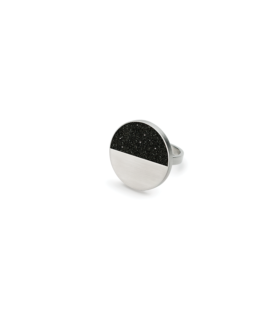 Cephei diamond dust infused concrete ring achieves minimalist beauty with modernist jewelry design that echoes architectural principles of balance, rhythm and harmony. Wear the night sky on your hand.