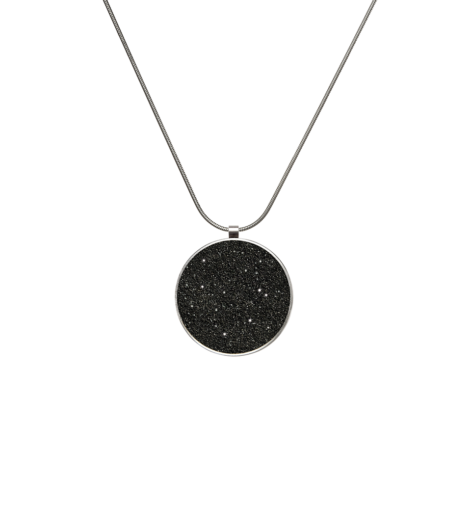 Maia concrete necklace set with diamond dust inside a minimalist stainless steel geometric form hanging centred from an elegant linked chain.