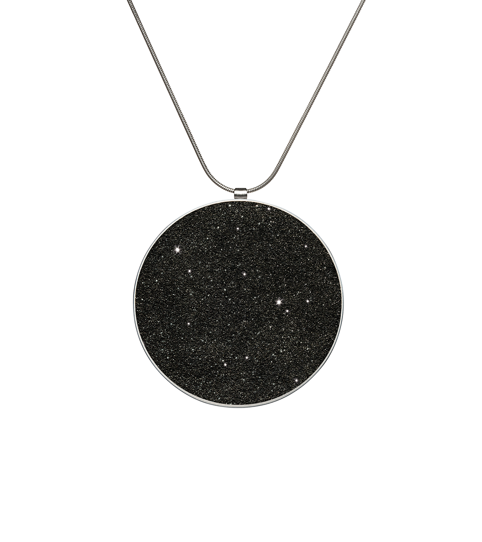 Maia Major concrete necklace set with diamond dust inside a minimalist stainless steel geometric form hanging centred from an elegant chain.