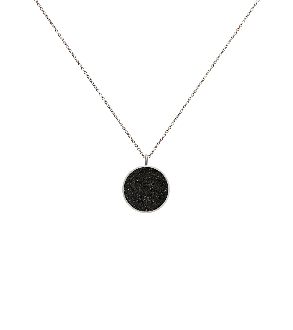 The Maia Minor concrete necklace sparkles with infused diamond dust set into stainless steel minimalist geometric form.