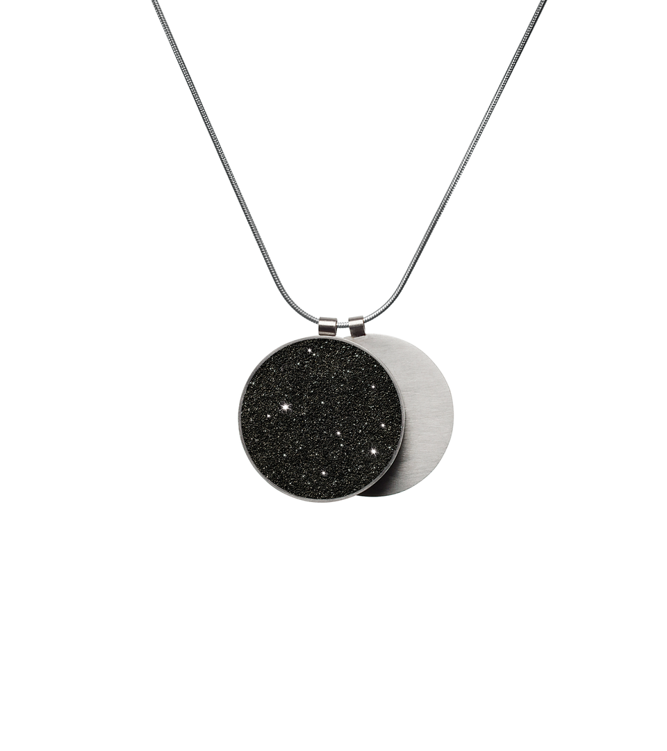 Overlapping double pendant in concrete, diamond dust and stainless steel hangs centred from a simple snake chain.