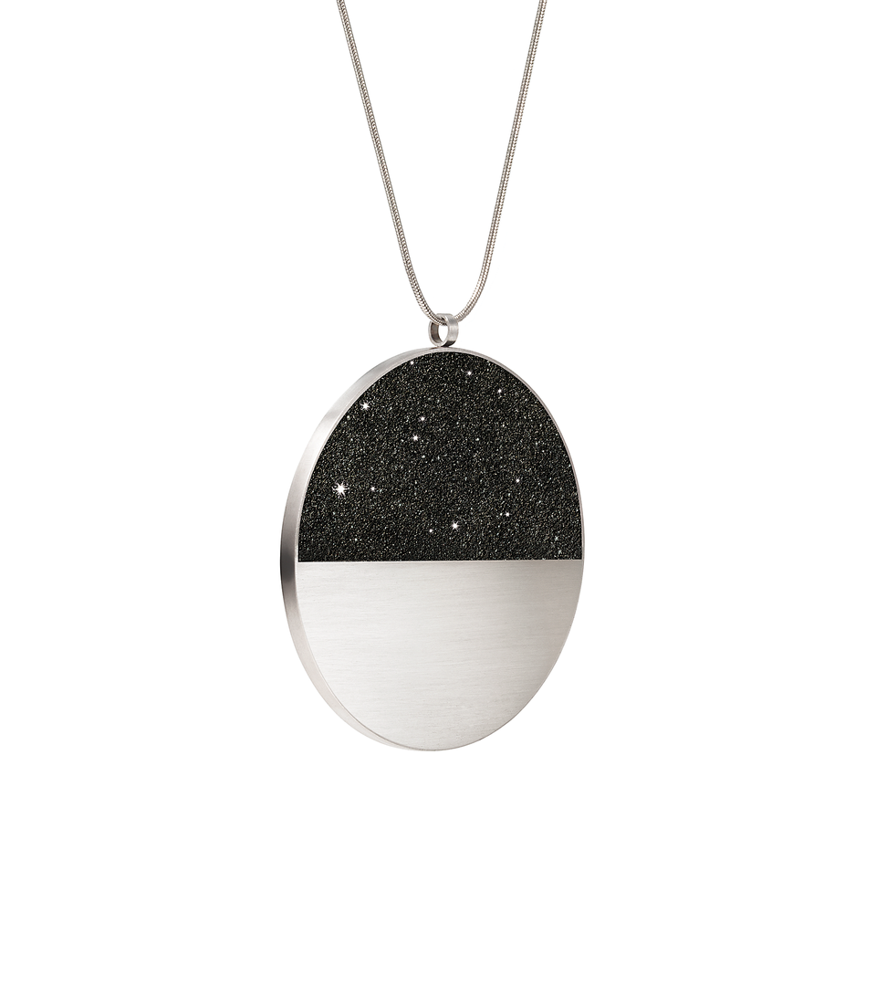 The statement sized Mira Major concrete and diamond dust necklace achieves minimalist beauty with modernist jewelry design that echoes architectural principles of balance, rhythm and harmony.