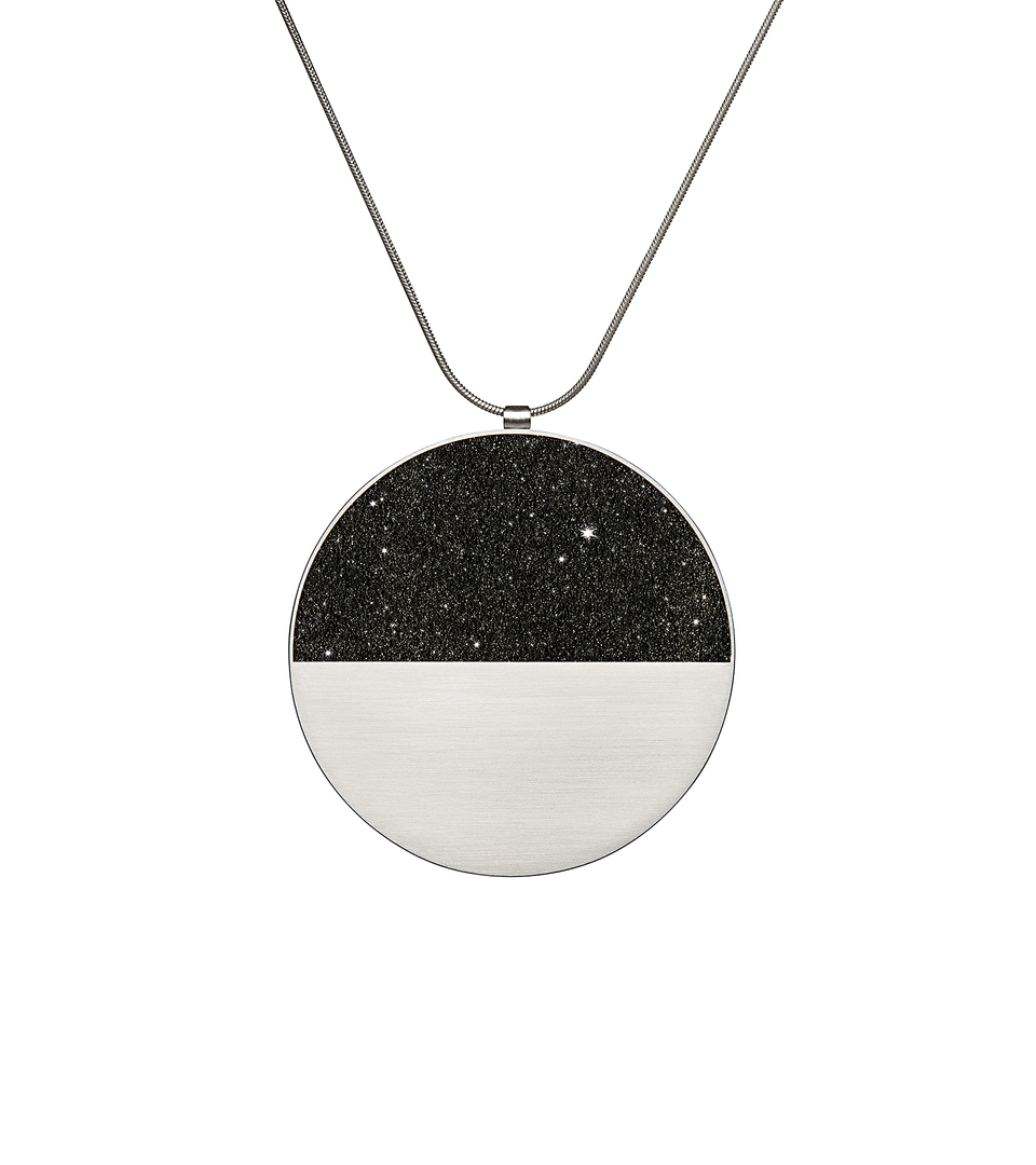 The larger sized Mira Major concrete and diamond dust necklace achieves minimalist beauty with modernist jewelry design that echoes architectural principles of balance, rhythm and harmony.