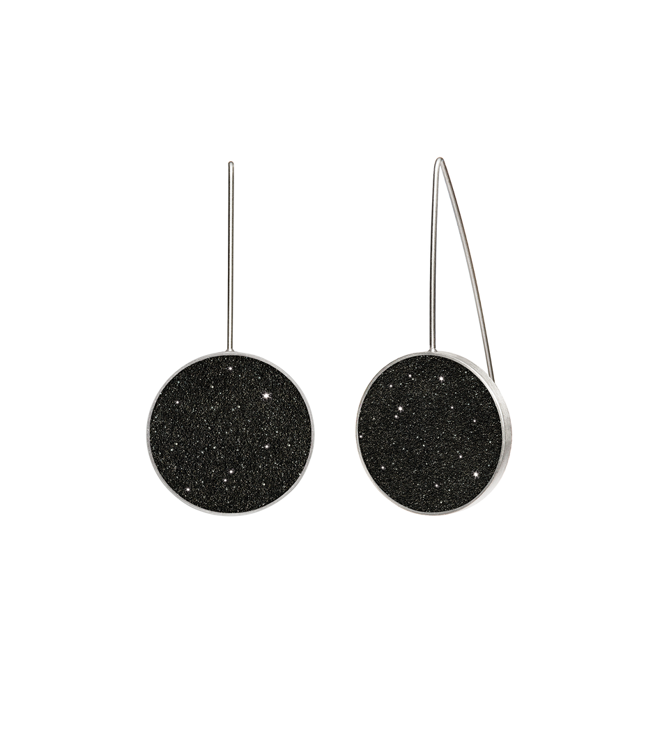 Musica concrete earrings, with the sparkle of diamond dust, is modernist jewelry design that echoes the infinite night sky.