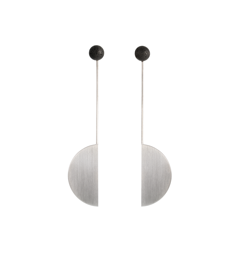 Pyxis earrings balance a concrete ball on a stainless steel minimalist geometric form.
