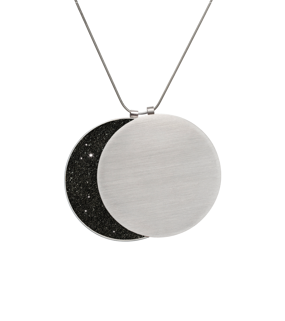 See the phases of the moon in this larger overlapping double pendant in concrete, diamond dust and stainless steel.