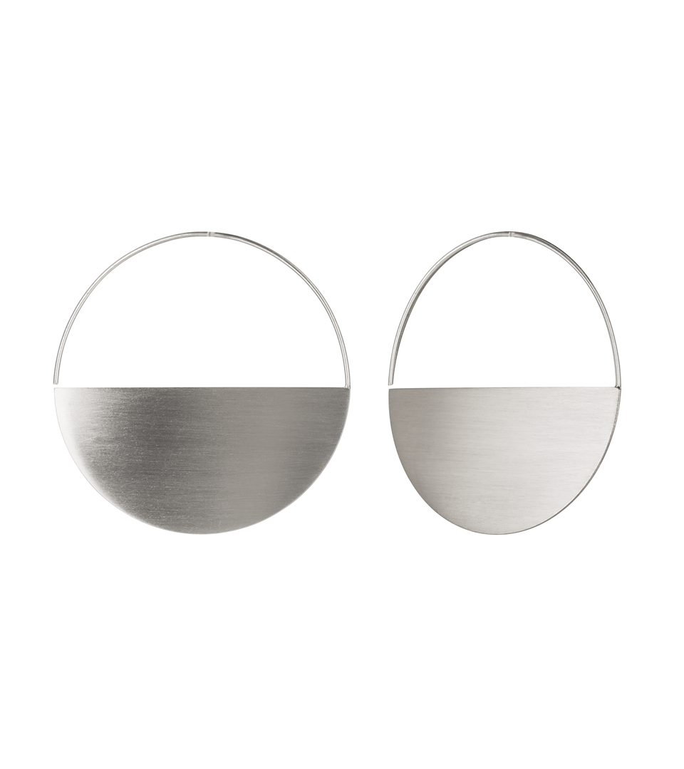 Minimalist Umbra Major hoops are characterized by .5mm thin brushed stainless steel half-circles measuring 45mm in diameter.