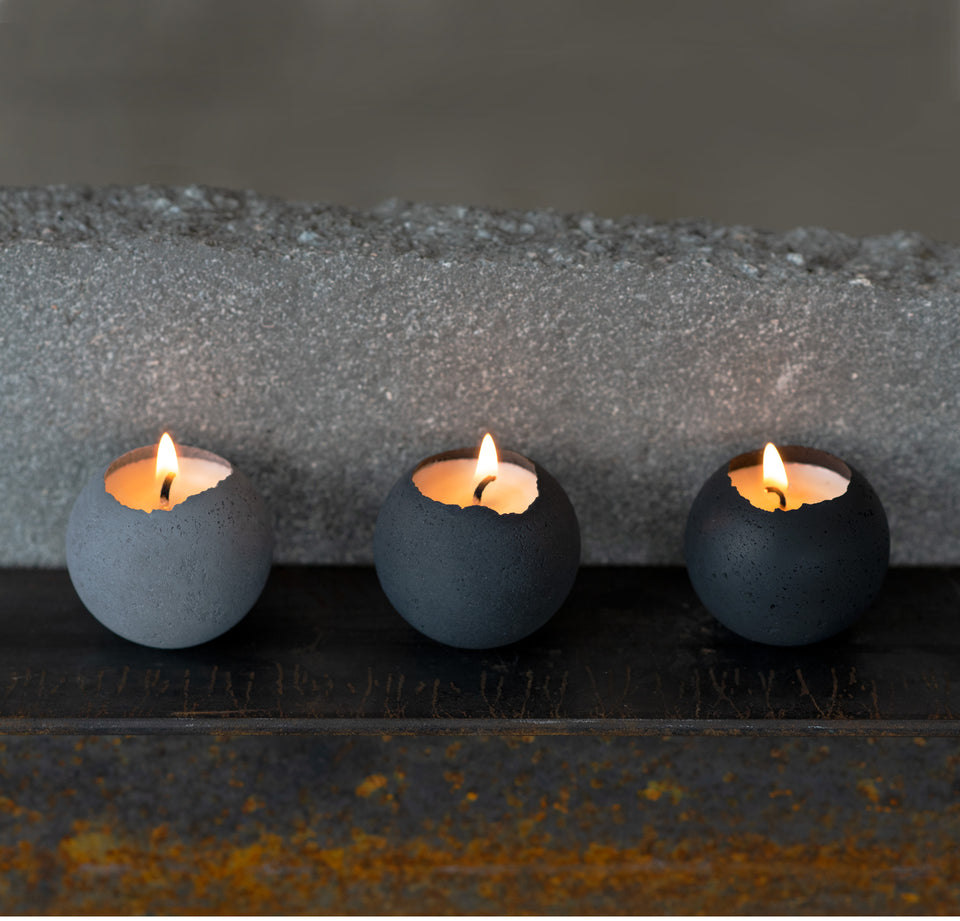 Concrete set of tealight candles in shades of grey.