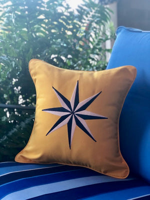 outdoor pillow with sunbrella fabric and custom embroidery rose compass