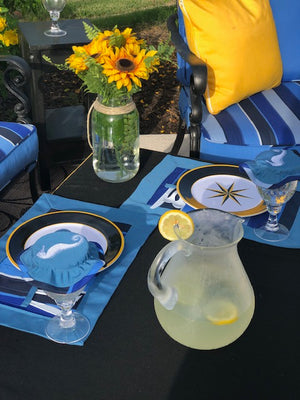 Outdoor placemat with utensil holder and drink cover