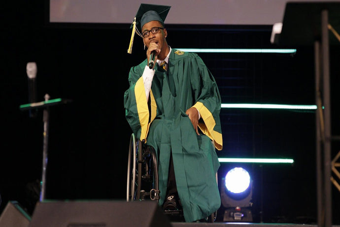 JACKSONVILLE TEEN WITH CEREBRAL PALSY WALK ACROSS THE STAGE AT GRADUATION CEREMONY