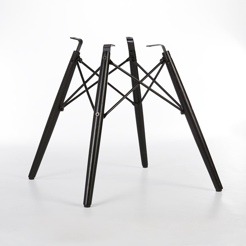 Angled rear view of black dowel base for Eames side and arm shells