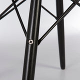Close up view of mid-section of black dowel base for Eames side and arm shells
