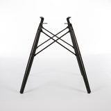Rear view of black dowel base for Eames side and arm shells
